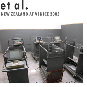 Project marketing material with image of two rows of dark grey trolleys holding computer equipment in a concrete room.  Artist name and New Zealand at Venice 2005 printed in top left corner.