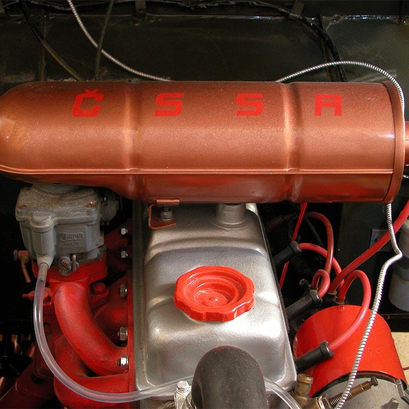 Trekka engine with Czechoslovak Socialist Republic initials printed in bright orange on cylinder.