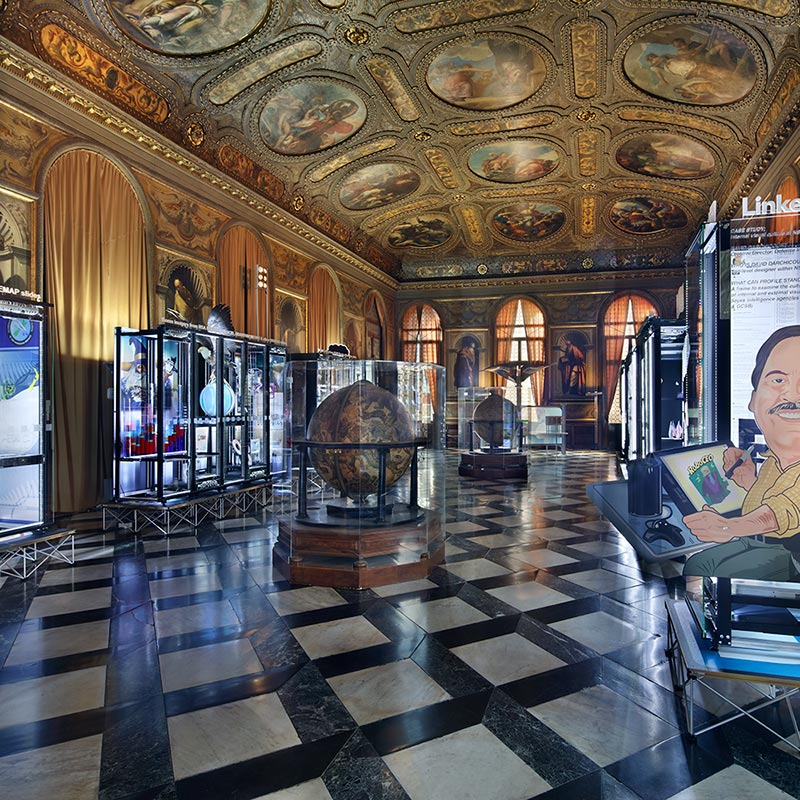 Monumental Rooms at the Biblioteca Nazionale Marciana Library with modded server-racks in background displaying interpretations of imagery from N S A TREASUREMAP Slides, and caricature of David Darchicourt as used in his LinkedIn Profile.