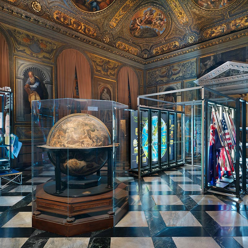 Monumental Rooms at the Biblioteca Nazionale Marciana Library with Vincenzo Coronelli Celestial Globe in glass casing, and David Darchicourt's map of Aotearoa New Zealand in background.