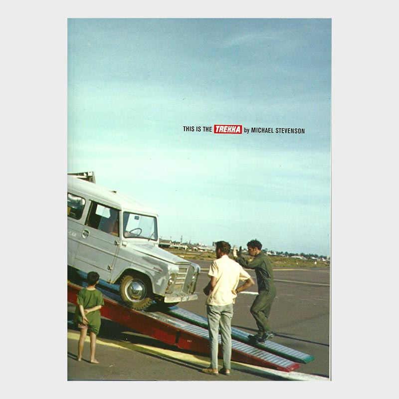 Book cover with image of two men monitoring a Trekka motor vehicle being unloaded down a cargo ramp.