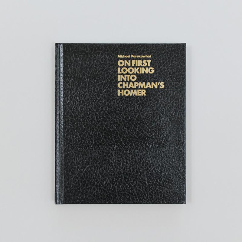 Cover of black exhibition catalogue with gold writing.