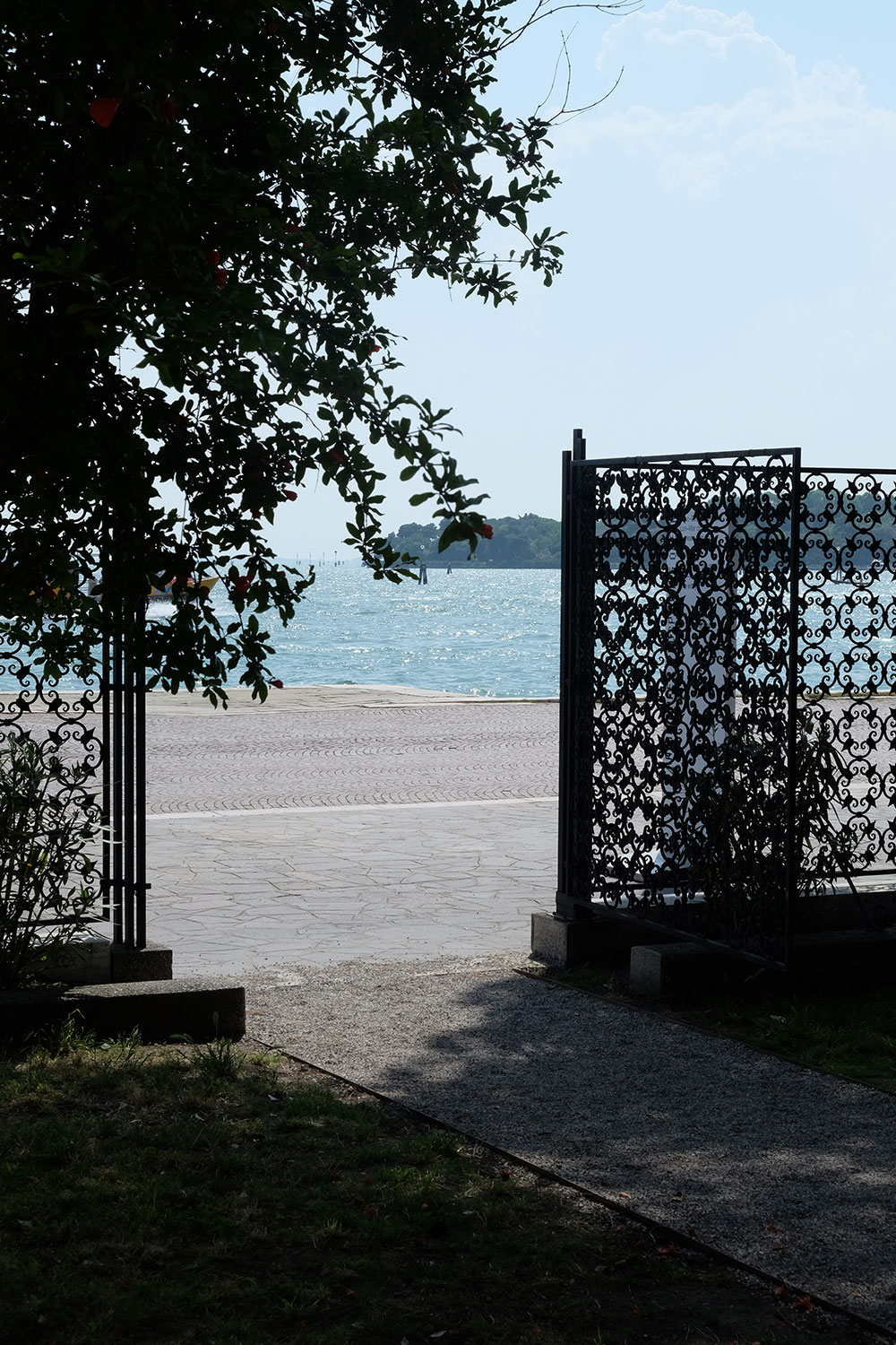 lagoon behind the Riva dei Sette Martiri, viewed through iron gates from the courtyard of the Palazzina Canonica